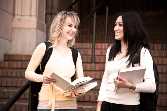 Two college students discussing in front of university
