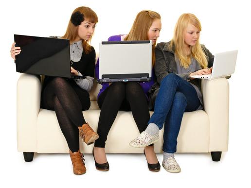 Teenage girls browsing through social media sites